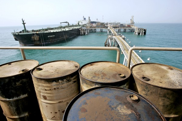 An oil tanker, Episkopi, is seen docked next to Iraq's vital al-Basra oil terminal, in Persian Gulf waters, Wednesday, Feb. 27, 2008. Crude oil prices fell more than $2 a barrel Thursday, April 24, 2008, as the dollar gained strength against the euro. (AP Photo/Kamran Jebreili)